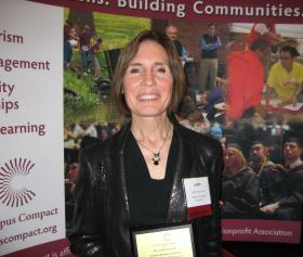 Judy Puncochar with her award in East Lansing.