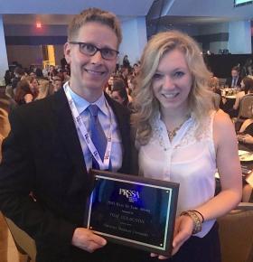 Isaacson with his award and NMU PRSSA President Katie Bultman