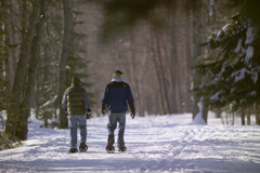 Two students snowshoeing at Presque Isle Park