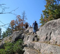 A student hikes up the rockface