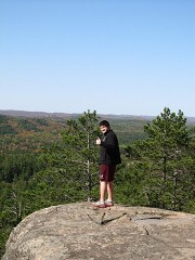 A student poses on Sugarloaf