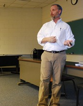 Harrington speaks in class