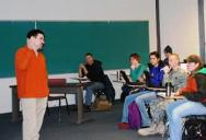 Kapla addresses a class full of students