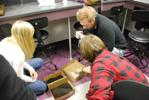 Students gather to make make a mold
