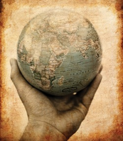 hand holding a globe of the world