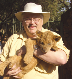 NMU prof. Bob Hanson with lion cubs