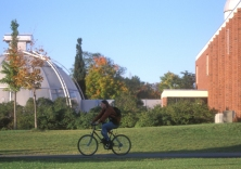 girl on bike on campus