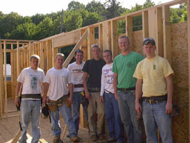 Community Partnership Program participants building a house