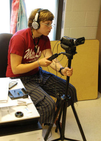 Student Laura Katona with video/audio recording equipment