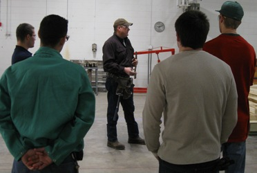A contractor talking to students.