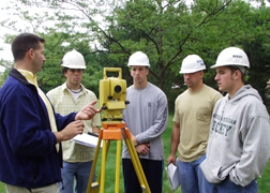 students and professor surveying