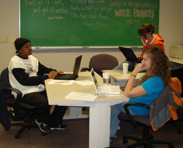 Krysthol Kauffman, Claire Abent, and Marcus Houston and writing papers for class.