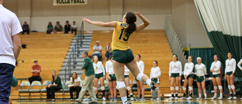 NMU Volleyball Player Serving