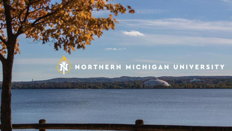 Photo of the Dome with the fall colors around it and the NMU logo over it