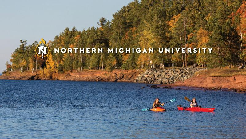 Students kayaking with the NMU logo over them