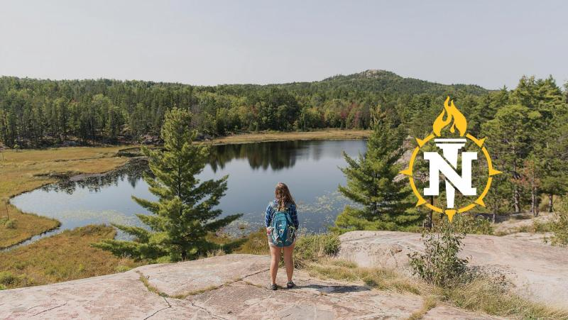 Student looking over Wetmore with the NMU torch overlayed