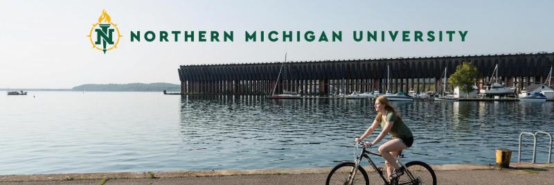 GIrl riding a bike with the NMU logo above her